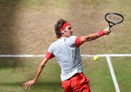 Федерер нарани ръката си по време на игра с близначките (снимка)