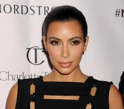 Ким Кардашян бременна, но в развод?