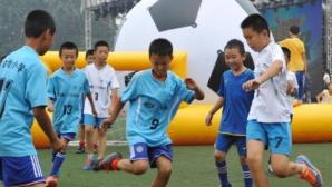 Китай отваря 50 000 футболни училища до 2025 година